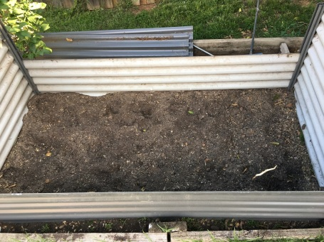 Box with bag of soil before chicken manure added